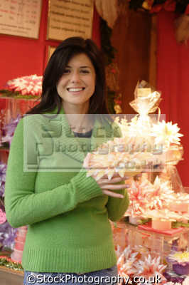 middle aged woman flower shop shopping retail purchase human activities people persons