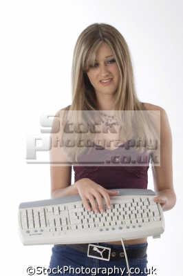 teenage girl computer keyboard people computers computing information technology human activities persons