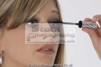 teenage girl applying eyelash makeup cosmetics make-up make up makeup fashion haute couture chic designer people persons