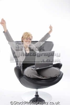 middle aged woman leather chair laptop celebrates women prime menopause female females feminine womanlike womanly womanish effeminate ladylike people persons winner