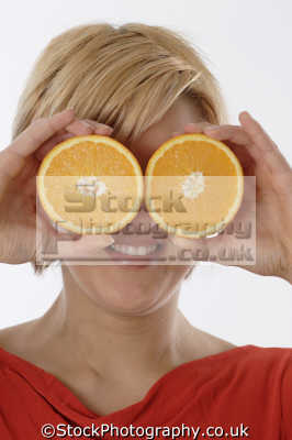 orange halves people eating mastication nutrition ingestion digestion meals food human activities persons binoculars