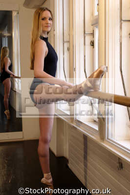 female ballet dancer working bar dancers ballerinas arts misc. leotard pose tiptoe
