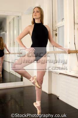 female ballet dancer working bar dancers ballerinas arts misc. leotard pose tiptoe