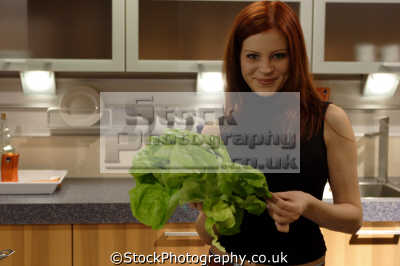 woman kitchen lettuce women cooking cookery cuisine meals housework domestic chores working people persons