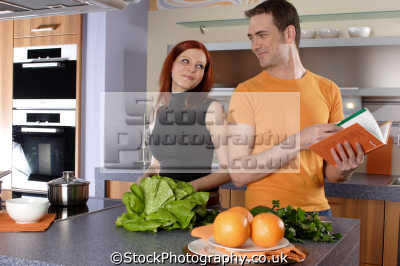 couple kitchen cooking cuisine housework domestic chores working people persons