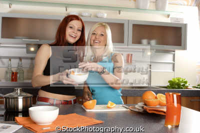 women smiling oranges cooking cookery cuisine meals housework domestic chores working people persons