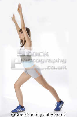 woman sports clothes stretching physical exercise athletic aerobic anaerobic health fitness people persons lunge