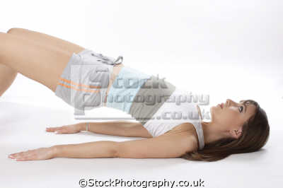 woman doing abdomen lifts physical exercise athletic aerobic anaerobic health fitness people persons tummy