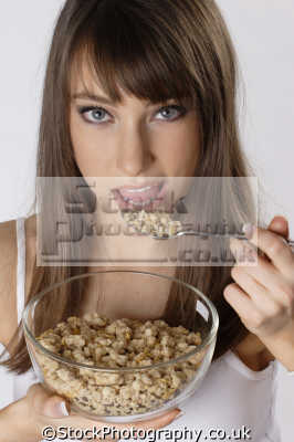 woman eating breakfast creal glass bowl people mastication nutrition ingestion digestion meals food human activities persons
