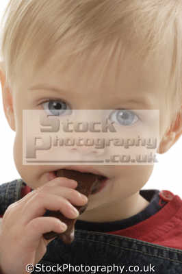 boy eating chocolate candy people mastication nutrition ingestion digestion meals food human activities persons sweets