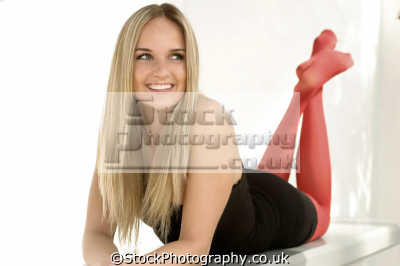 teenage girl black dress red stockings smiling fashion haute couture chic designer people persons crimped hair