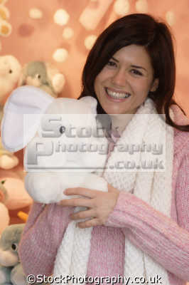 smiling woman fluffy toy smiles facial expression pleasure amusement faces visage people persons cuddley