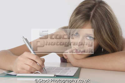 teenage girl filling questionaire students learning working people persons student writing
