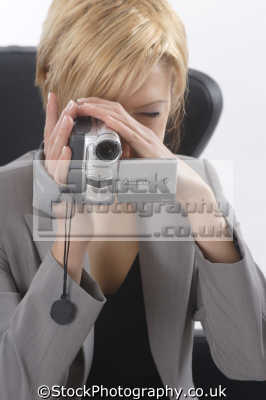 woman business suit filming video camcorder photography imaging arts misc.