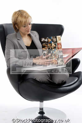 middle aged woman looking photo album photography imaging arts misc.