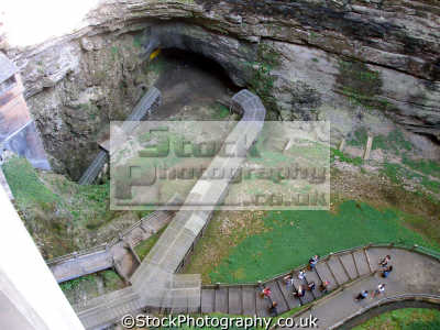 gouffre padirac entrance 20km cave system. public visits include gondola underground river. gouffe grotto tourist attraction french european travel chasm abyss cavern stalactite calcite limestone lot midi-pyrenees midi pyrenees midipyrenees france la francia frankreich europe