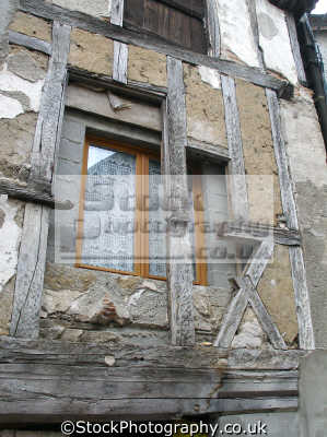 old new. inner wall modern window half-timbered half timbered halftimbered facade. beaulieu-sur-dordogne beaulieu sur dordogne beaulieusurdordogne department corrèze france. french buildings european travel wood-framed wood framed woodframed ancient dessicated mediaeval medieval correze limousin france la francia frankreich europe