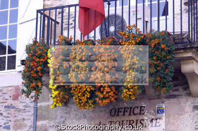 floral display outside mayor office tourist village donzenac department corrèze france french buildings european travel balcony orange red yellow flowers correze limousin la francia frankreich europe