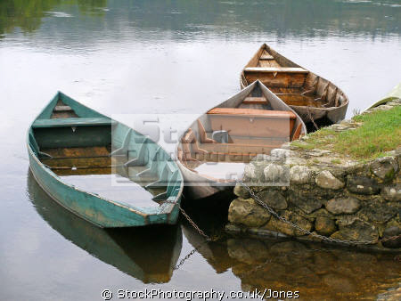 rowing boats dordogne river department corrèze france. french landscapes european travel humorous humourous humour beaulieu limousin correze waterlogged flooded france la francia frankreich europe