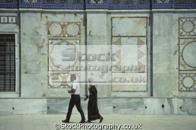 couple visiting dome rock old city jerusalem. called europeans mosque omar umar earliest remaining islamic monument. haram es-sharif es sharif essharif noble sanctuary temple mount. middle east travel arabia muslim octagonal shrine moriah qubbat as-sakhrah as sakhrah assakhrah israel jewish israeli
