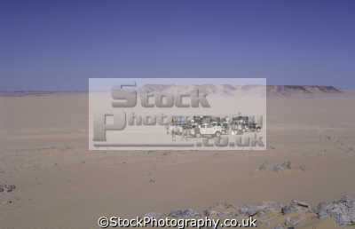 preparing camp desert central sahara niger africa. land rover series iii. off-road off road offroad motoring driving motor cars automobiles transport transportation uk africa lan...