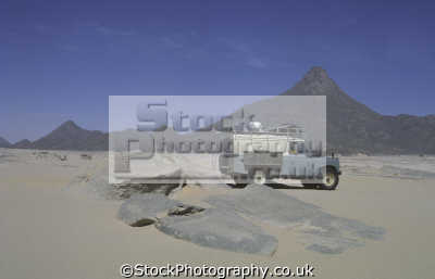 ton series iia model land rover mount tiska sahara desert. northern algeria africa off-road off road offroad motoring driving motor cars automobiles transport transportation uk rovers sand expedition blue be... algerian