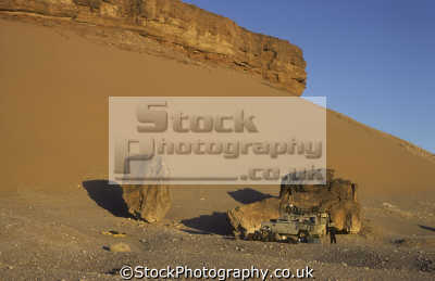 sahara desert cold evening wear warm clothes. land rover series iii near salah central algeria africa off-road off road offroad motoring driving motor cars automobiles transport transportation uk ... algerian