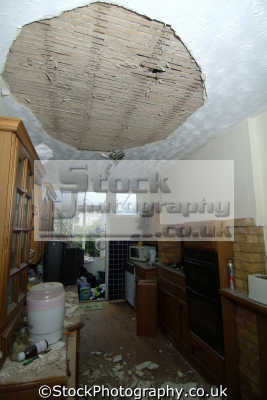 collapsed ceiling kitchen kitchens cooking interiors inside british housing houses homes dwellings abode architecture architectural buildings uk insurance claim middlesex middx england english great britain united kingdom