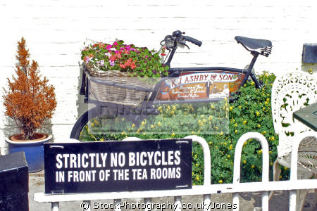 say ... spotted outside lock house tea rooms trent derbyshire. bicycles cycling cyclists bikes transport transportation uk humorous humourous humour bicycle bike butchers grocers fence flowers derbyshire england english great britain united kingdom british