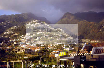 madeira northern suburbs funchal looking inland. portuguese portugese european travel mountainous valley stormy evening sunset madiera portugal europe