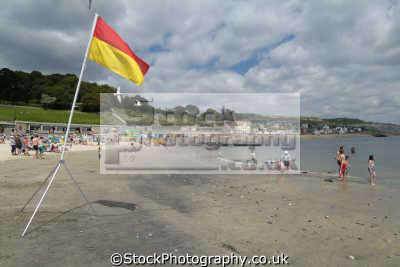 lyme regis dorset west beach lifeguard duty flag british beaches coastal coastline shoreline uk environmental safety england english great britain united kingdom