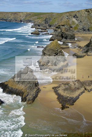 bedruthan steps newquay cornwall british beaches coastal coastline shoreline uk environmental sandy beach sea cliffs atlantic ocean rollers breakers turquoise cave rocky shore cornish england english great britain united kingdom