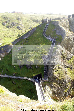 steps bridge leading castle island tintagel cornwall. uk coastline coastal environmental camelot king arthur round table west country tristan isolt mark uther pendragon merlin magician cornwall cornish england english great britain united kingdom british