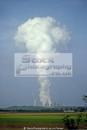 global warming steam rising cooling towers power station near karlsruhe germany. german deutschland european travel humorous humourous humour ecology environmental heat pollution atmosphere atmospheric weather air germany europe germanic