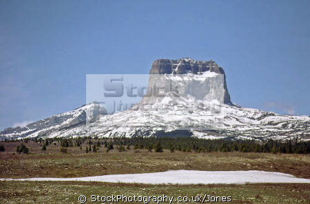 chief mountain montana usa. rock formations geology geological science butte blackfoot indian reservation winter snow kings peak glacier national park np cirrus united states american
