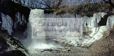 minnehaha falls city minneapolis spring thaw. waterfalls cascade cataracts geology geological science misc. torrent creek winter minnesota water ice usa united states america american