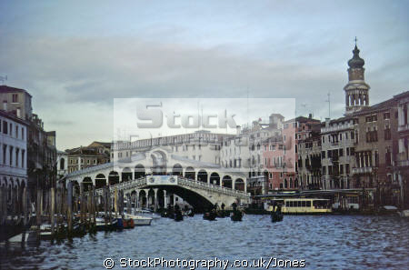 venice rialto grand canal late winter afternoon. north east italy italian european travel gondola gondolier waterbus vaporetto bridge pont puente italia venezia waterfront palazzo palace water taxi venitian italien italie europe