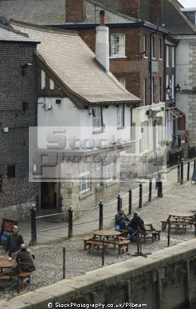 kings arms pub river embankment york. flood water regularly floods bar pub. public houses tavern alchohol british architecture architectural buildings uk outdoor drinking old cobbles york yorkshire england english great britain united kingdom