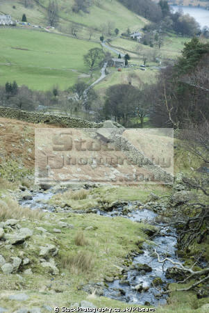 large boulder set stone wall glenridding lake district british lakes countryside rural environmental uk lakeland stream cumbria cumbrian england english great britain united kingdom