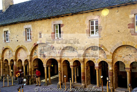 old pilgrimage town conques france. cloisters near abbey church sainte foy. french buildings european travel way st james jacques route ste aveyron midi-pyrenees midi pyrenees midipyrenees basilica eglise medieval santiago compostela france la francia frankreich europe