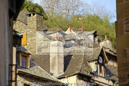 old pilgrimage town conques france. study traditional quercy rooftops. french buildings european travel way st james jacques lauzes schist fishscale route ste aveyron midi-pyrenees midi pyrenees midipyrenees abbey church sainte foy basilica eglise medieval santiago compostela france la francia frankreich europe