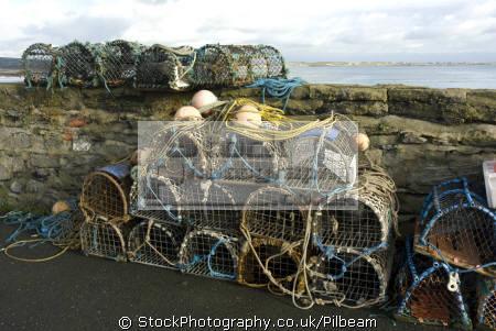 traditional lobster pots harbour wall harbor uk coastline coastal environmental fishing local sea manx fresh isle man england english great britain united kingdom british