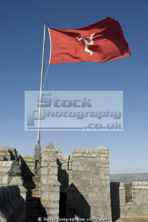 legs man manx flag flagpole castle. nationalities nations misc. red flying blue sky isle england english great britain united kingdom british