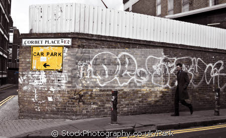man walking street brick lane men adult males masculine manlike manly manful virile mannish people persons fashion wall coat signal graffiti london england uk tower hamlets cockney english great britain united kingdom british
