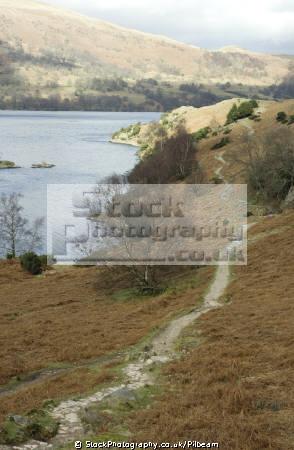 narrow winding footpath alongside ullswater lake. lake district north west northwest england english uk lakes cumbria cumbrian great britain united kingdom british