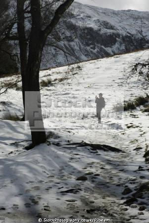 walker taking photograph snow lake district north west northwest england english uk photo hiking walking fells snowy cumbria cumbrian great britain united kingdom british