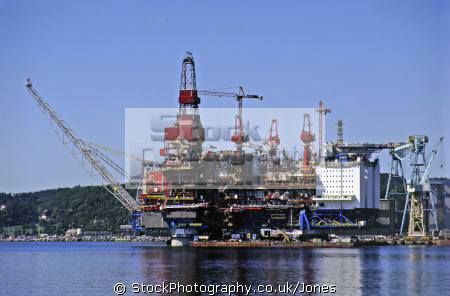 oil production platform completed refitted karmoy island near bergen norway industry industrial uk business commerce rig flare derrick petroleum crude hydrocarbon north sea statoil fjord kongeriket norge norwegan