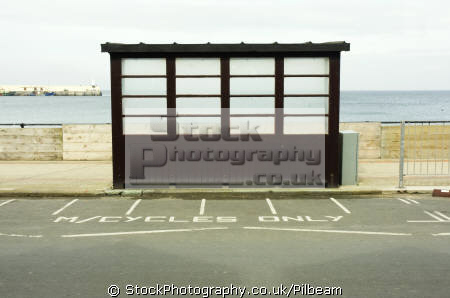 seaside shelter peel isle man motorcycle bay. british coastal resorts leisure uk sea beach rain road wooden manx iom england english great britain united kingdom