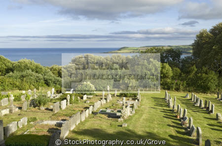 cemetry overlooking sea st mawnan parish church mawnan. uk churches worship religion christian british architecture architectural buildings grave yard resting place view tranquil countryside rural picturesque falmouth cornwall cornish england english great britain united kingdom