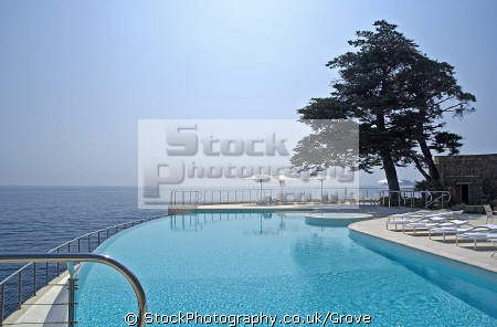infinity swimming pool hotel cap estel èze-bord-de-mer èze bord de mer èzeborddemer cotes azure. provence cote azur riviera mediterranean south french european travel blue azure eze hedonism hedonistic france jacuzzi leisure luxury nice pleasure plunge sea sky stainless steel sunsine upmarket upscale provence-alpes-côte provence alpes côte provencealpescôte la francia frankreich europe